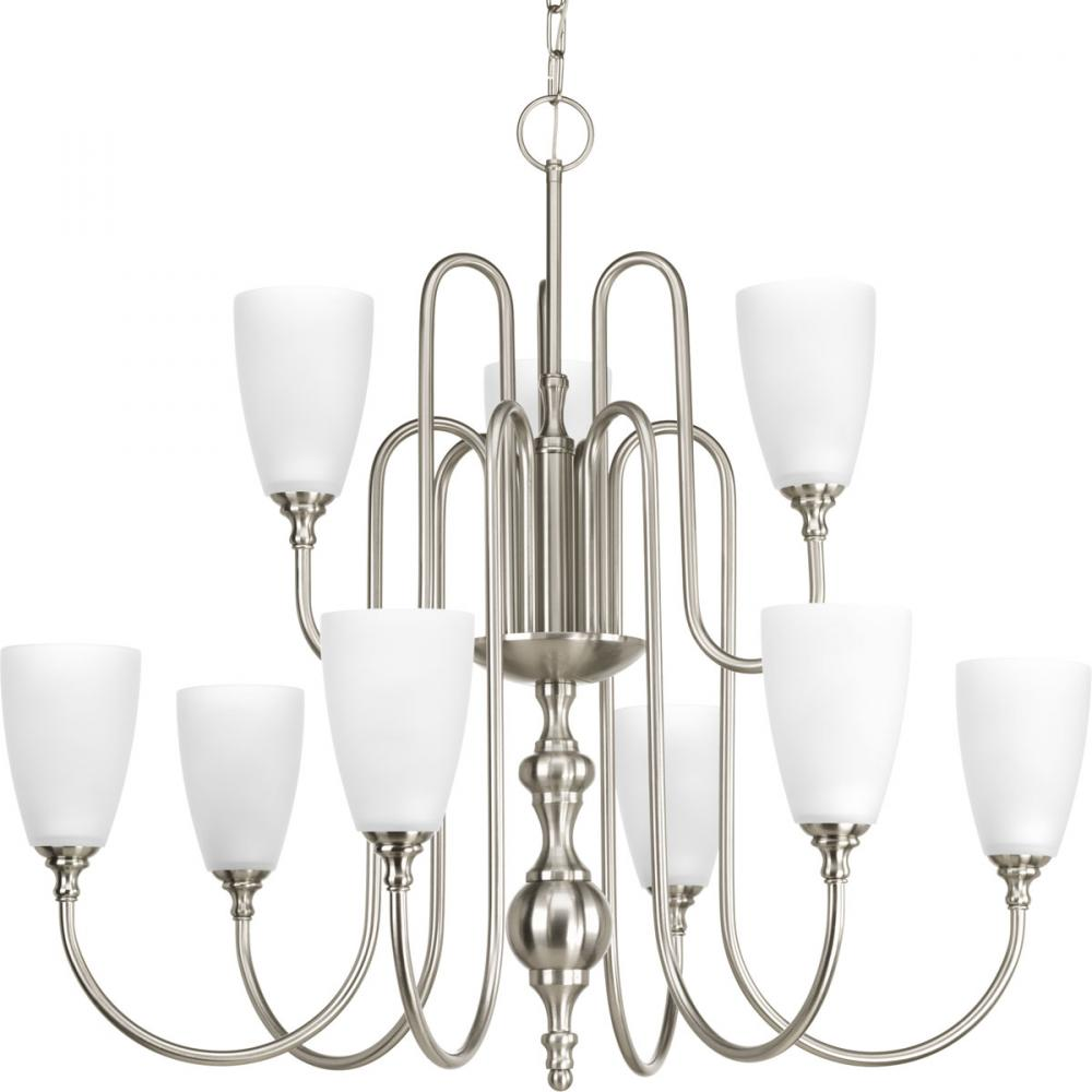 Nine-light, two-tier chandelier finished in brushed nickel with etched glass.